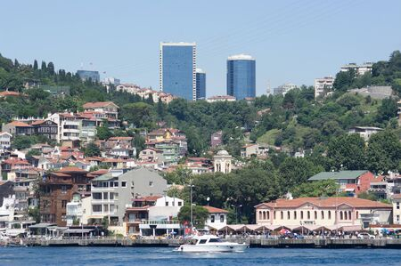 the Arnavutkoy village on the Bosporus waterfront is a historic neighborhood in Istanbul on the background the skyscrapers of modern Levent neighborhood photo