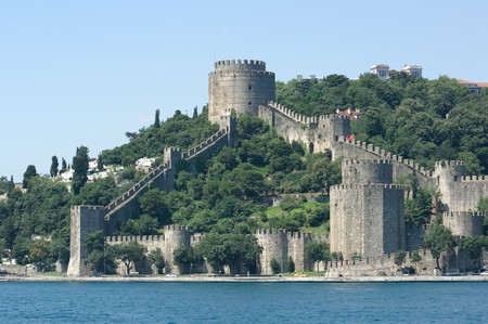 towers and crenellated walls of Rumelis fortress on the Bosporus waterfront, Istanbul photo