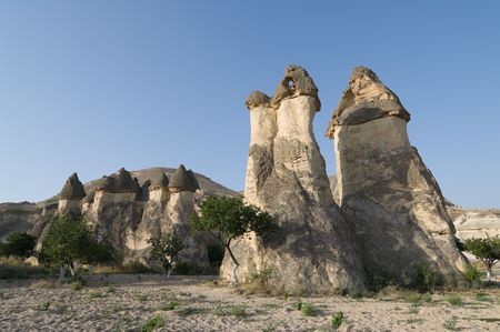 rock formation: group of fairy chimneys typical rock formation in Goreme, Cappadocia - Turkey  Stock Photo