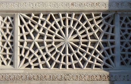 iznik: carving geometrical decorations on the white stone in Iznik, Turkey