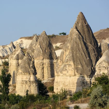 group of fairy chimneys typical rock formation in Goreme, Cappadocia - Turkey  photo
