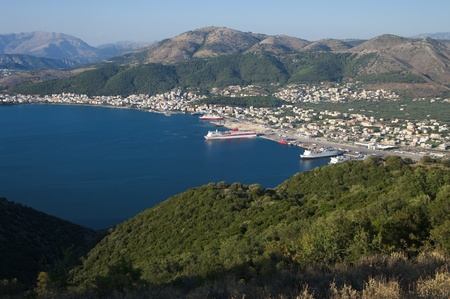 aerial view of the seacoast and the skyline of Igoumenitsa with ferry boats moored in his commercial harbor photo