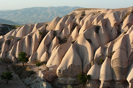volcano slope: typical rock formations at the twilight in Cappadocia, Turkey