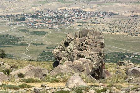inactive: volcanic rock cracked near inactive volcano Hasan, on background Helvadere village, Cappadocia Turkey
