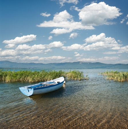metallic rowboat on beach of lake Prespa, Stenje - Macedonia