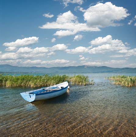 metallic rowboat on beach of lake Prespa, Stenje - Macedonia