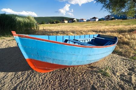 fishing village: metallic rowboat on beach of lake Prespa, Stenje - Macedonia