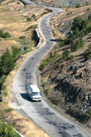 aerial view of car crosses a mountain road in southeastern of Albania photo