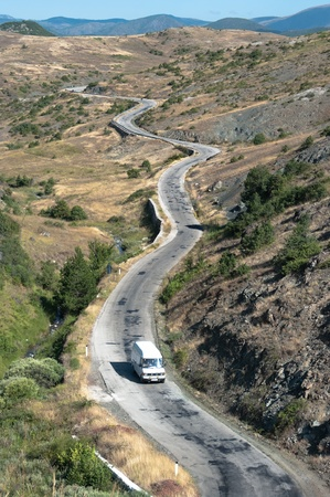aerial view of car crosse a mountain road in southeastern of Albania photo