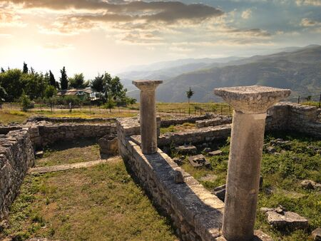 albania: sunset on the columns of episcopal complex in ancient city of Byllis, Albania