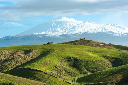 the majestic Etna dominates the rolling hills of the hinterland of Sicily