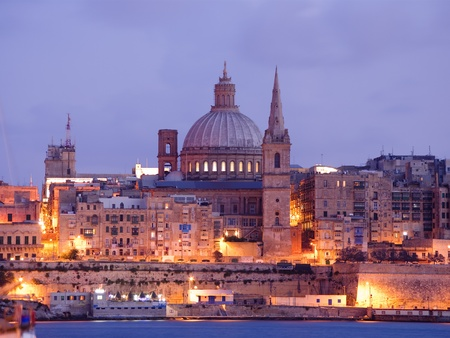 Malta: night View of Valletta with the St. Pauls Cathedral and Charmelite Church at the twilight