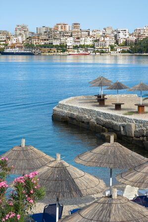 albanian: waterfront of Saranda, one of the most important tourist attractions of the Albanian Riviera (beach umbrella)