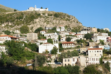 the village of Dhermi, dominated by white church of St. Mary on the hill Stock Photo - 11813214