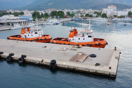 Bar, Montenegro - July 09, 2013  two tugboats moored in the Port of Bar  A tugboat is a boat that maneuvers vessels by pushing or towing them   Stock Photo - 22201671