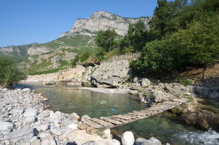 albanian: small wooden bridge on a tributary creek of Cemi River in Commune Kelmend, Albania