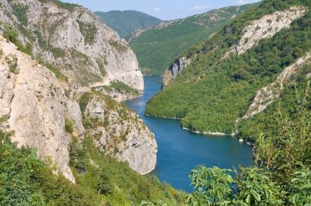 albania: blue water of Koman-Fierza Lake between steep cliffs, Albania