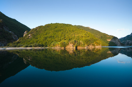 albanian: coast reflection on Koman-Fierza Lake, Albania