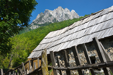 albanian: Rrogam village and peak of albanian Alps in Valbona Valley, Albania