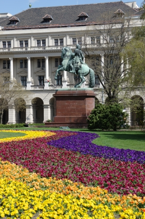 obuda: Budapest, Kossuth square  colorful flowerbed and the equestrian statue of the national hero Francis II Rákóczi with the famous motto   Cum Deo Pro Patria et Libertate  written on marble base