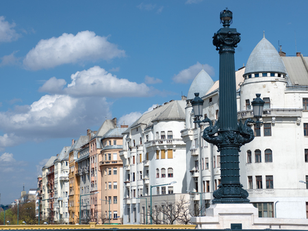 abodes: Budapest  artistic street lamp on Chain bridge and typical architecture of palaces on the Danube riverside of Pest