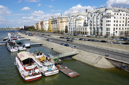 Budapest, Hungary - April 04, 2012  tourist boats moored and typical architecture of palaces on the Danube riverside of Pest near the Chain Bridge Stock Photo - 22201728