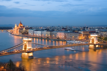 Budapest, night view of Chain Bridge on the Danube river and the city of Pest photo