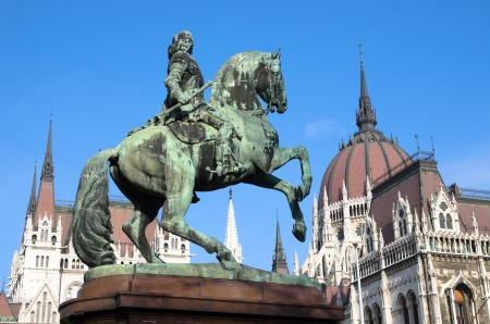 obuda: Budapest, Kossuth square  the equestrian statue of the national hero Francis II Rakoczi and the cupola and spires of Hungarian Parliament Building Stock Photo