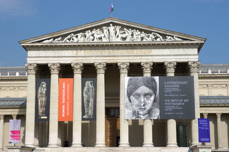 obuda: Budapest, Hungary - April 05, 2012  front view of the Museum of Fine Arts  Hungarian  Szépmuvészeti Múzeum  in an eclectic-neoclassical style  On the facade some posters illustrate some exhibitions in progress  The museum is located in Heroes Editorial
