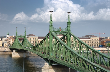 the Liberty Bridge (sometimes Freedom Bridge) in style Art Nouveau connects Buda and Pest across the River Danube in Budapest Stock Photo - 22200060
