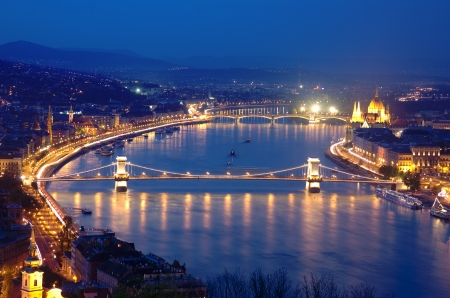 obuda: night view of Chain Bridge on the Danube river and the city of Budapest
