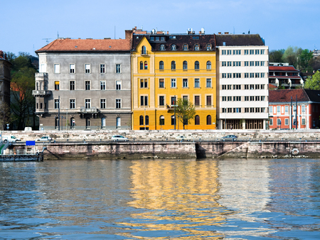 obuda: colored buildings are reflected on the river Danube in Budapest