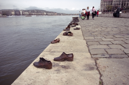 copyright protection              Budapest, Hungary - April 06, 2012  The  Shoes on the Danube Promenade  is a memorial created by Gyula Pauer and Can Togay on the bank of the Danube River in Budapest  It honors the Jews who were killed by  Arrow Cross  m
