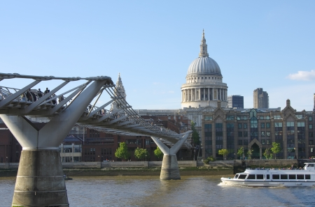 London Millennium Footbridge on Thames River and dome of St  Paul photo