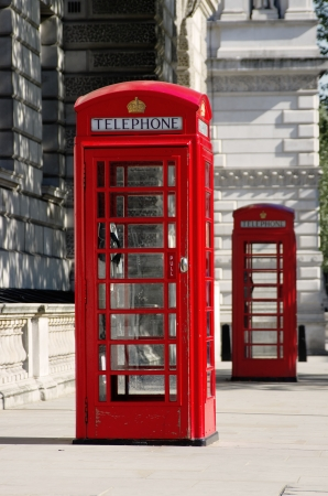 two red phone boxes old style in London in row  shallow depth of field