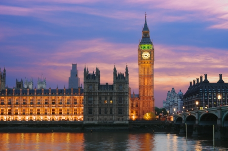 Big Ben and Houses of Parliament on the Thames River in London City Westminster at twilight
