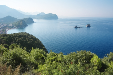 islets: dawns on the coast between Budva and Bar, Montenegro  In the bay are two islets called Katic and Sveta Nedjelja