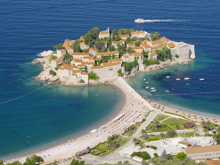 budva: high view of fortified village on the islet Sveti Stefan, Montenegro