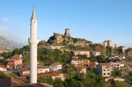 minaret: view of the minaret of the Kruja village, the Clock Tower and National Museum in Skanderbeg Castle, Albania