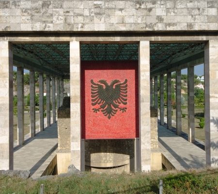 double headed: Lezhe, Albania - July 30, 2012  the double-headed eagle, the national flag of the Albanians, on the facade of Skanderbeg Mausoleum in Lezhe - Albania