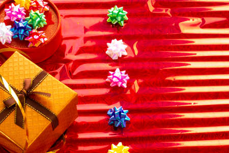 New Years gifts, sweets and festive ribbons on a colored background. holiday, giving, new year, christmas, birthday Stock fotó
