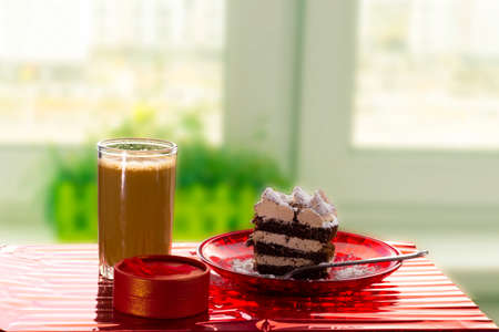 Sweet call with coffee, cake and gift on the window