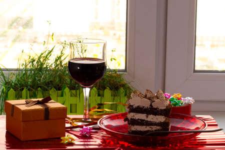 poppy cake with hazelnut Bizet and wine on the background of beige organza