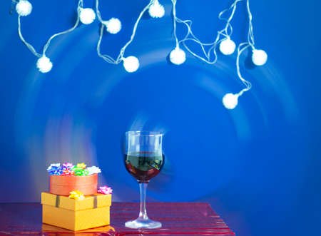 wine and gift on a blue background with room for text. Holiday concept Stock fotó