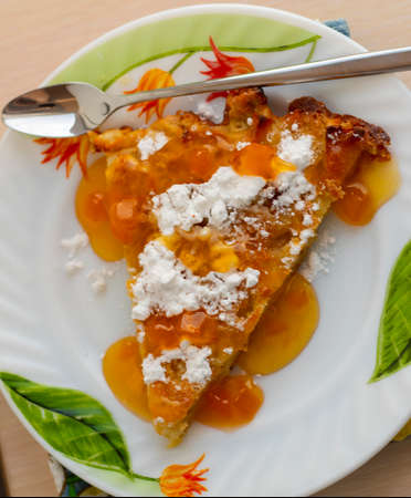 sweet pie on a plate and dessert spoon