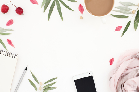 Round framed floral pattern, lifestyle white workplace, womens things, smartphone, note, scarf, cup of coffee