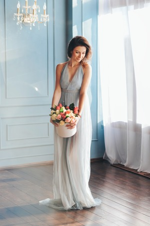 girl with bouquet roses, received as a gift