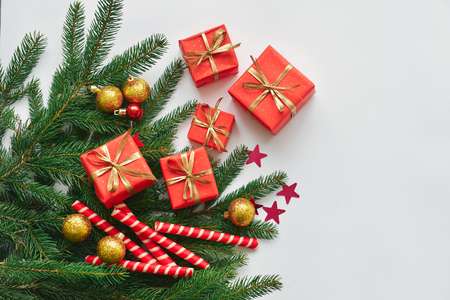 christmas composition, spruce branches to gifts in red boxes, christmas decor Stock Photo