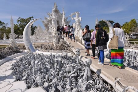 Wat Rong Khun, White temple in Thailand with tourists