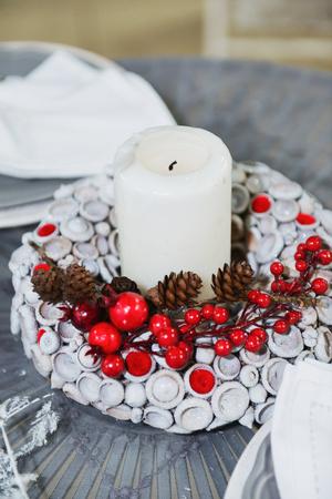 Christmas decor Festive table setting. New Years floral arrangement Stock Photo